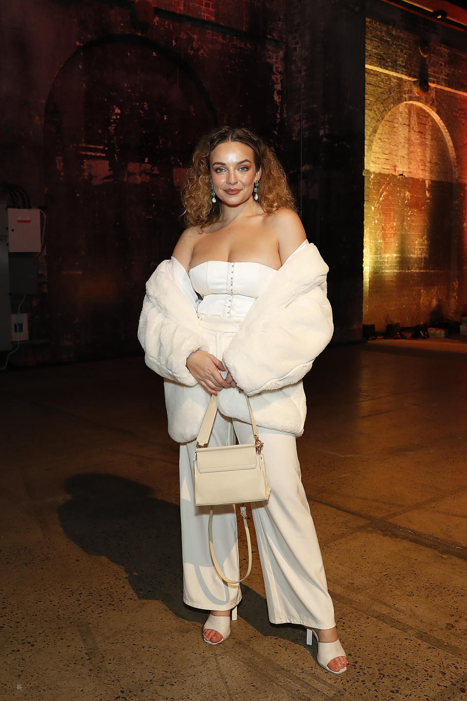 Abbie Chatfield wears an all-white outfit at the Manning Cartell show during Afterpay Australian Fashion Week 2021 Resort '22 Collections at Carriageworks on June 03, 2021 in Sydney, Australia
