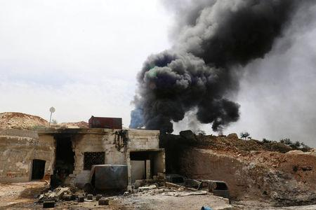 Smoke rises from an emergency service point after an airstrike at the rebel-held village of Maar Zita in Idlib province