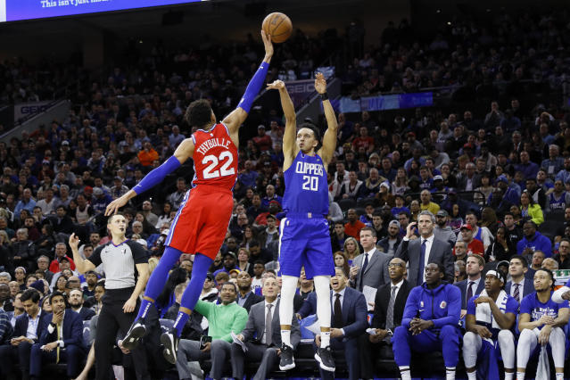 Los Angeles Clippers' Landry Shamet, right, cannot get a shot past Philadelphia 76ers' Matisse Thybulle during the first half of an NBA basketball game, Tuesday, Feb. 11, 2020, in Philadelphia. (AP Photo/Matt Slocum)