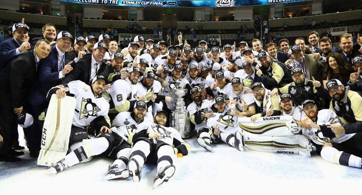 Jim Rutherford's Penguins pose with the Stanley Cup. (Bruce Bennett/Getty Images/AP)