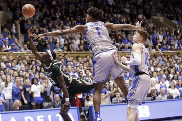 Colorado State guard Kendle Moore (3) drives to the basket while Duke center Vernon Carey Jr. (1) and guard Alex O'Connell (15) defend during the first half of an NCAA college basketball game in Durham, N.C., Friday, Nov. 8, 2019. (AP Photo/Gerry Broome)