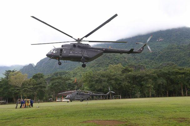 PHOTO: A military transport helicopter prepares to carry drill machine to be used for the search of missing 12 boys and their soccer coach, in Mae Sai, Chiang Rai province, in northern Thailand, July 2, 2018. (Sakchai Lalit/AP)