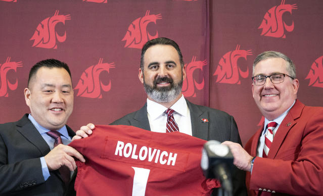New Washington State football coach Nick Rolovich, center, is introduced by Washington State Athletic Director Pat Chun, left, and Washington State President Kirk Schulz during a press conference on Thursday, Jan. 16, 2020, in Pullman, Wash. (Pete Caster/Lewiston Tribune via AP)