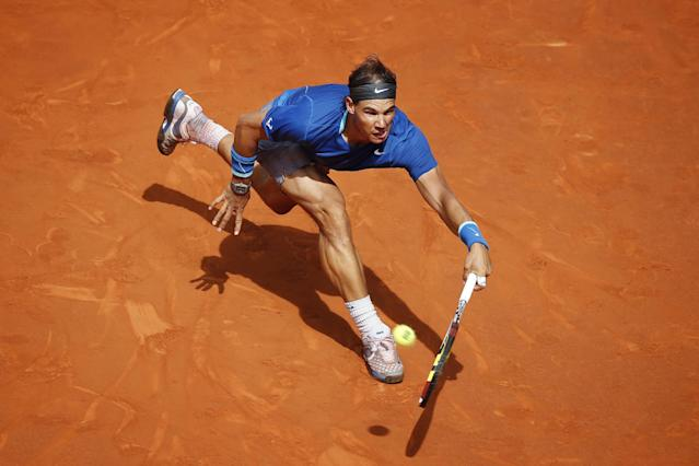 Rafael Nadal from Spain returns the ball during a Madrid Open tennis tournament match against Roberto Bautista from Spain in Madrid, Spain, Saturday May 10, 2014 . (AP Photo/Daniel Ochoa de Olza)