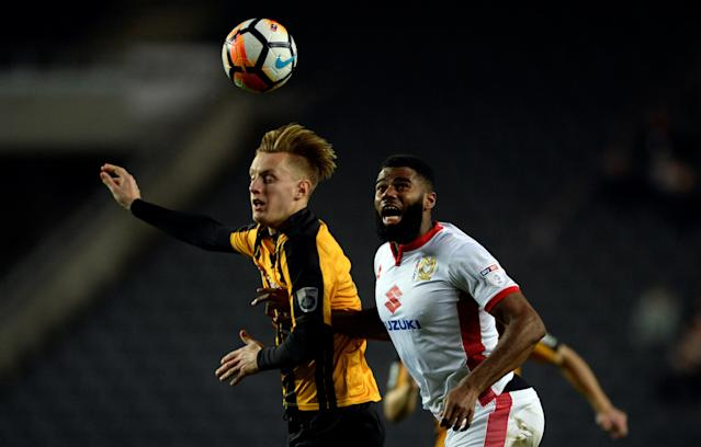 Soccer Football - FA Cup Second Round - Milton Keynes Dons vs Maidstone United - Stadium MK, Milton Keynes, Britain - December 2, 2017 MK Dons' Ethan Ebanks-Landell in action with Maidstone United's Joe Pigott Action Images/Adam Holt