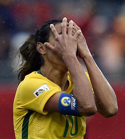 Brazil's midfielder Marta reacts to her teams' loss to Australia in their 2015 FIFA Women's World Cup round of 16 match at Moncton Stadium, in New Brunswick, Canada on June 21, 2015 (AFP Photo/Franck Fife)