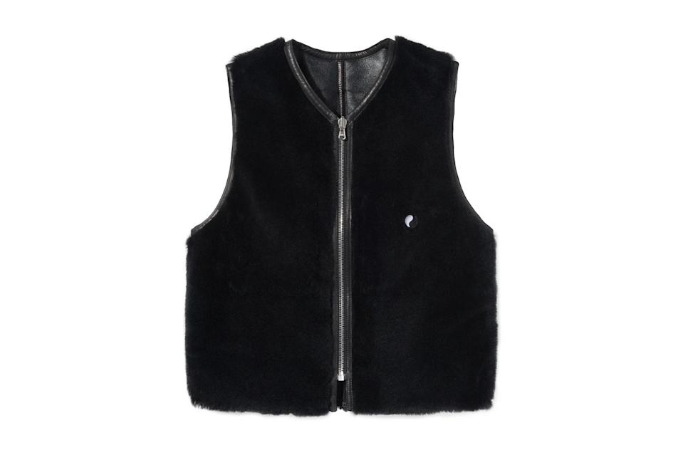 "$725, Stüssy. <a href=""https://www.stussy.com/collections/new-arrivals/products/reversible-shearling-vest-black-shearling?variant=39274028859488"" rel=""nofollow noopener"" target=""_blank"" data-ylk=""slk:Get it now!"" class=""link rapid-noclick-resp"">Get it now!</a>"