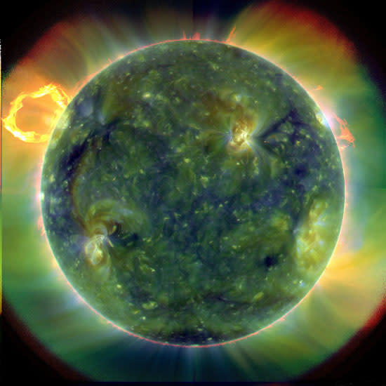 This image provided Wednesday, April 21, 2010 by NASA shows an eruptive prominence blasting away from the sun, upper left, March 30, 2010 observed by the Solar Dynamics Observatory satellite. NASA on Wednesday unveiled the first images from the new satellite designed to predict disruptive solar storms, and scientists say they're already learning new things. (AP Photo/NASA)