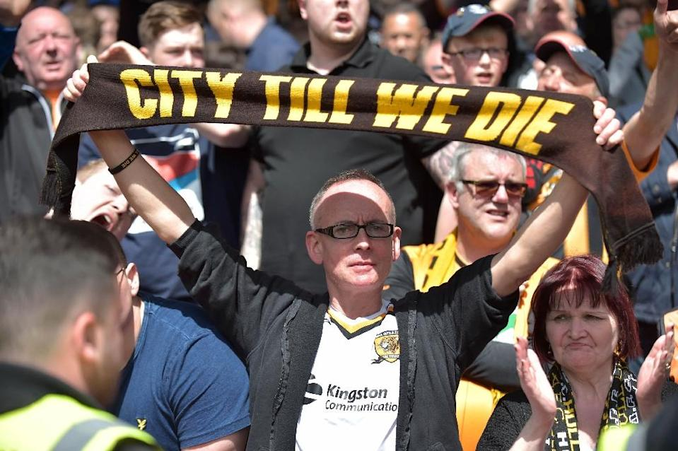 Hull City fans at Crystal Palace's Selhurst Park ground in south London on May 14, 2017, the day their team was relegated from the Premier League (AFP Photo/Olly GREENWOOD)