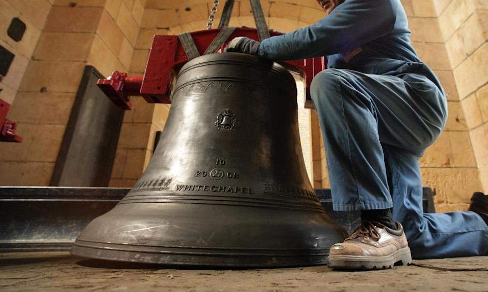 Peter Scott, a senior bell hanger for the Whitechapel Bell Foundry, manoeuvres a bell into the church of St Magnus the Martyr on 2 March 2009 in London.
