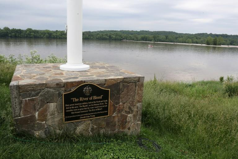 A plaque honoring Civil War dead at the Trump National Golf Club with the the Potomac River in the background
