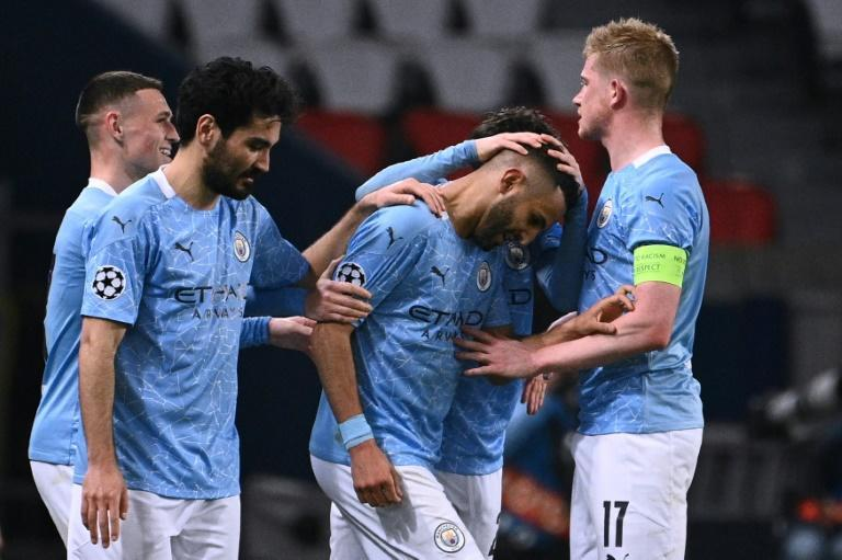 Manchester City players congratulate Riyad Mahrez after his free-kick gave the English side a 2-1 win in Paris