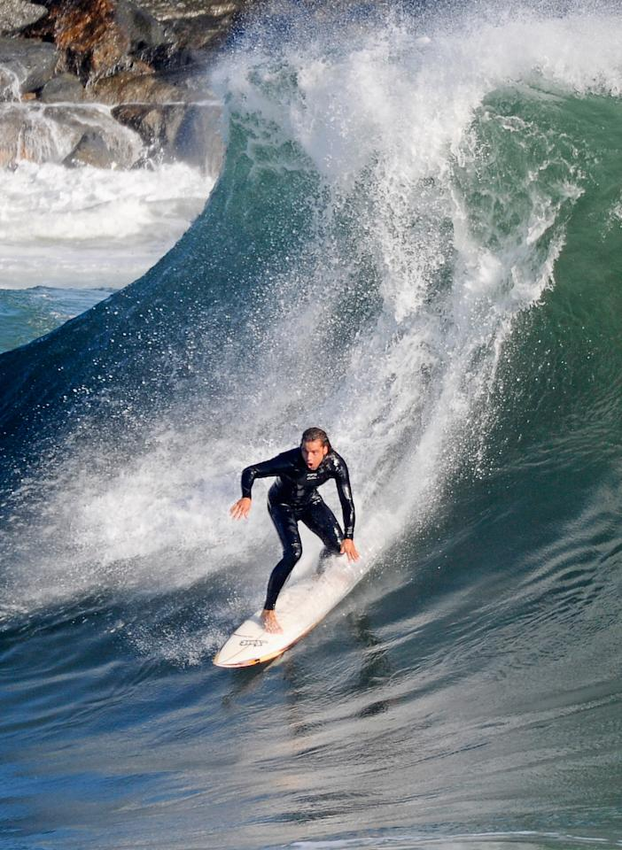 NEWPORT BEACH, CA - SEPTEMBER 01:  A surfer rides a high wave at The Wedge on September 1, 2011 in Newport Beach, California. Waves measuring up to 20 feet pounded the beach. A winter storm off the coast of Australia and New Zealand brought unusually high surf to the Southern California beaches.  (Photo by Kevork Djansezian/Getty Images)