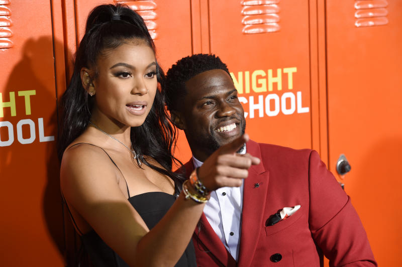"Kevin Hart, right, a cast member, producer and co-writer of ""Night School,"" poses with his wife Eniko Parrish at the premiere of the film, Monday, Sept. 24, 2018, in Los Angeles. (Photo by Chris Pizzello/Invision/AP)"
