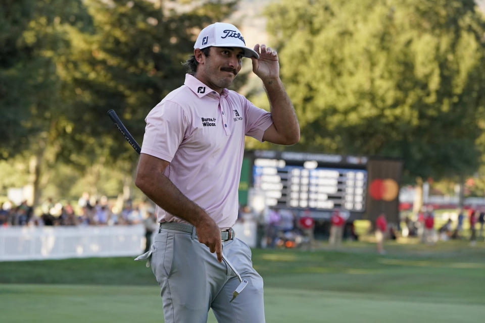 Max Homa acknowledges the crowd on the 18th green of the Silverado Resort North Course after finishing the final round of the Fortinet Championship PGA golf tournament Sunday, Sept. 19, 2021, in Napa, Calif. Homa won the tournament. (AP Photo/Eric Risberg)