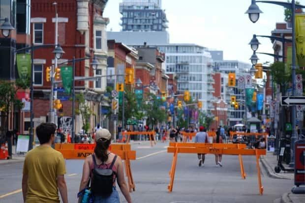 People walk down a closed-off stretch of Bank Street in Ottawa on July 10, 2021, during the COVID-19 pandemic. (Joseph Tunney/CBC - image credit)