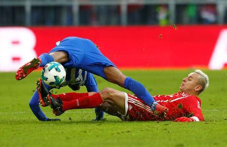 Soccer Football - Bundesliga - Bayern Munich vs Hertha BSC - Allianz Arena, Munich, Germany - February 24, 2018 Bayern Munich's Rafinha in action with Hertha Berlin's Valentino Lazaro REUTERS/Michaela Rehle