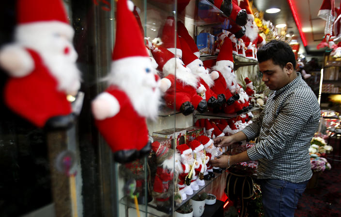 Image: A Palestinian store owner decorates a Santa at his shop in Gaza City, Wednesday, Dec. 18, 2019. (AP Photo/Hatem Moussa)