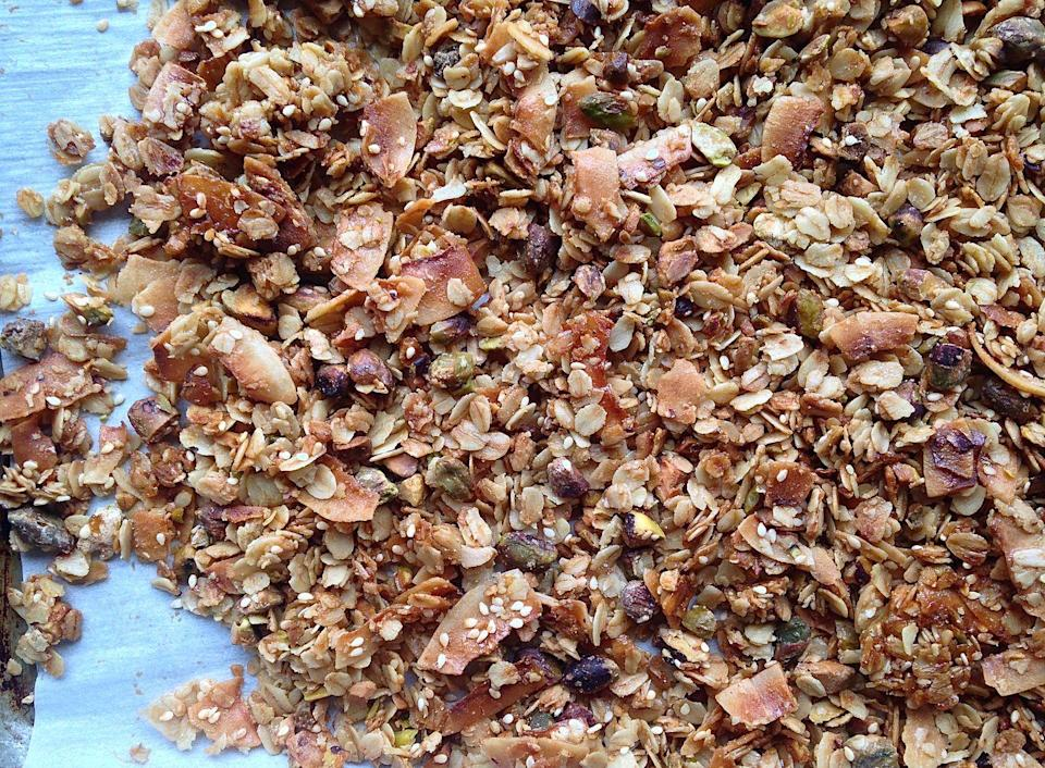 "<p>A granola that everyone will love. It's great over yogurt or on its own!</p><p>Get the recipe from <a href=""https://www.delish.com/cooking/a41910/best-granola-recipe/"" rel=""nofollow noopener"" target=""_blank"" data-ylk=""slk:Delish"" class=""link rapid-noclick-resp"">Delish</a>. </p>"