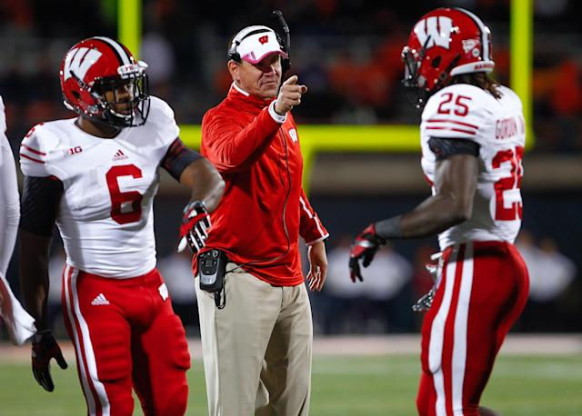 CHAMPAIGN, IL - OCTOBER 19: Head coach Gary Anderson of the Wisconsin Badgers congratulates Melvin Gordon #25 of the Wisconsin Badgers after a touchdown against the Illinois Fighting Illini at Memorial Stadium on October 19, 2013 in Champaign, Illinois. Wisconsin defeated Illinois 56-32. (Photo by Michael Hickey/Getty Images)