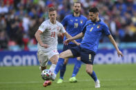Italy's Jorginho gets the ball past Spain's Dani Olmo during the Euro 2020 soccer semifinal match between Italy and Spain at Wembley stadium in London, Tuesday, July 6, 2021. (Laurence Griffiths, Pool via AP)