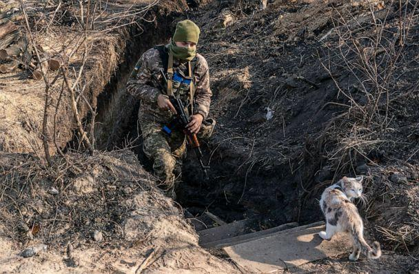 PHOTO: FILE- In this Nov. 2, 2019, file photo, a Ukrainian serviceman walks up from a trench at the new line of contact in Zolote, Luhansk region, eastern Ukraine. (Evgeniy Maloletka/AP, File)