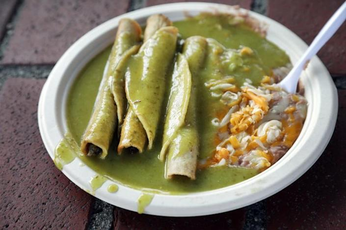 LOS ANGELES, CA -- NOVEMBER 06, 2019: Cielito Lindo has been serving taquitos since 1934. These are beef taquitos in their signature avocado sauce. (Myung J. Chun / Los Angeles Times)