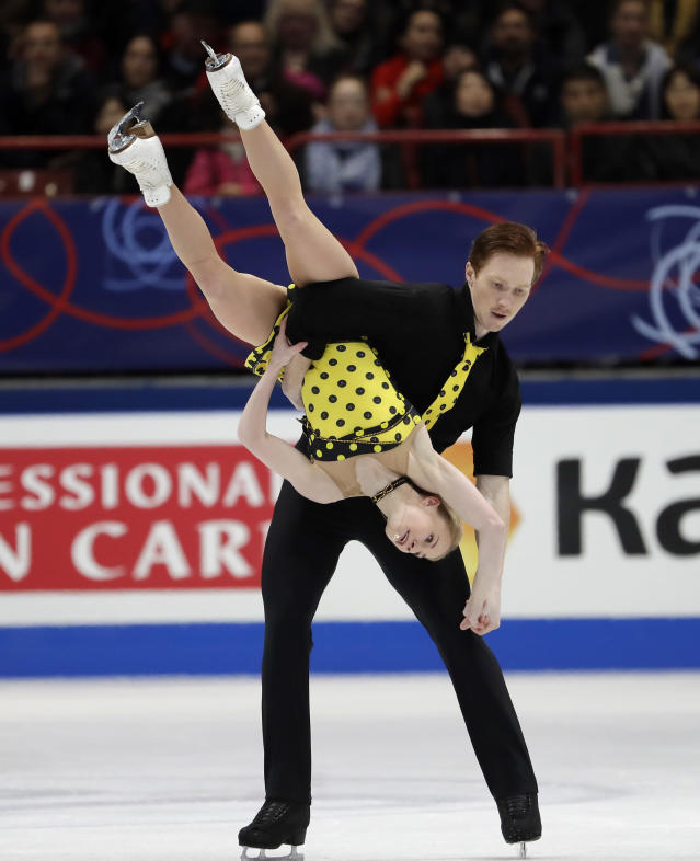 Russia's skaters Evgenia Tarasova and Vladimir Morozov perform during pairs free skating program at the Figure Skating World Championships in Assago, near Milan, Thursday, March 22, 2018. (AP Photo/Luca Bruno)
