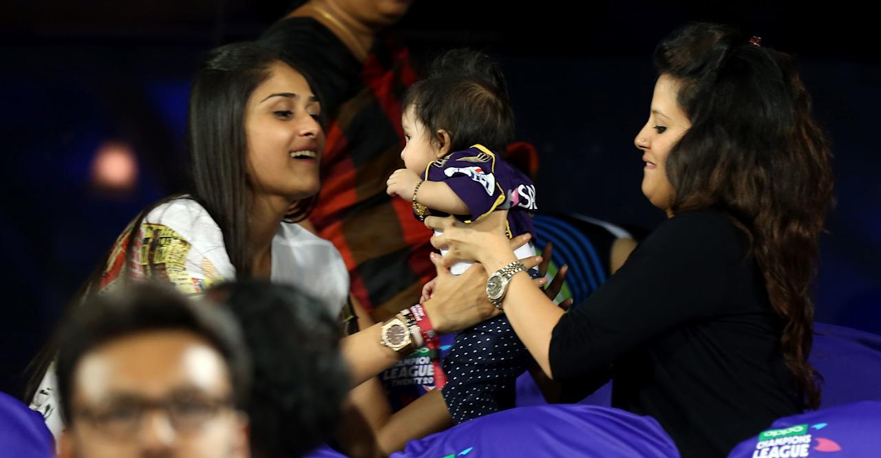 Poorna Patel and  Sakshi wife  of M S Dohni captain of  Chennai Super Kings with Daughter of Gautam Gambhir captain of Kolkata Knight Riders during match 1 of the Oppo Champions League Twenty20 between the Kolkata Knight Riders and the Chennai Superkings held at the Rajiv Gandhi Cricket Stadium, Hyderabad, India on the 17th September 2014  Photo by:  Sandeep Shetty / Sportzpics/ CLT20   Image use is subject to the terms and conditions as laid out by the BCCI/ CLT20.  The terms and conditions can be downloaded here:  https://ec.yimg.com/ec?url=http%3a%2f%2fsportzpics.photoshelter.com%2fgallery%2fCLT20-Image-Terms-and-Conditions-2014%2fG0000IfNJn535VPU%2fC0000QhhKadWcjYs&t=1500922058&sig=BY1pwyNVQmOW6EQ262PdfQ--~C