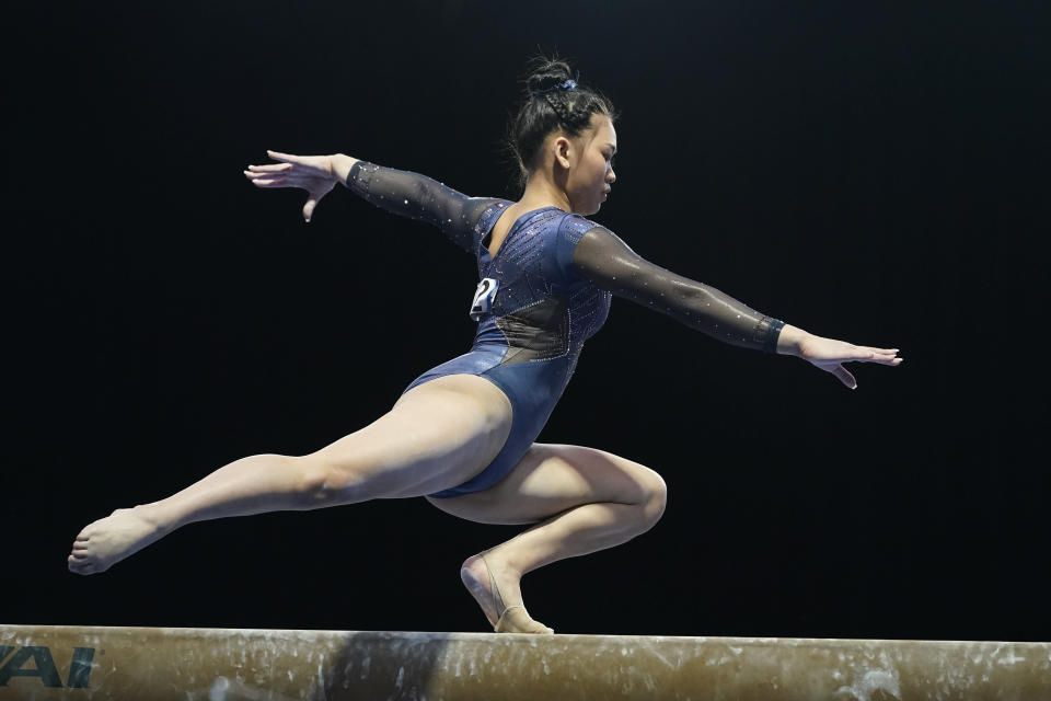 Sunisa Lee performs on the balance beam during the Winter Cup gymnastics competition, Saturday, Feb. 27, 2021, in Indianapolis. (AP Photo/Darron Cummings)