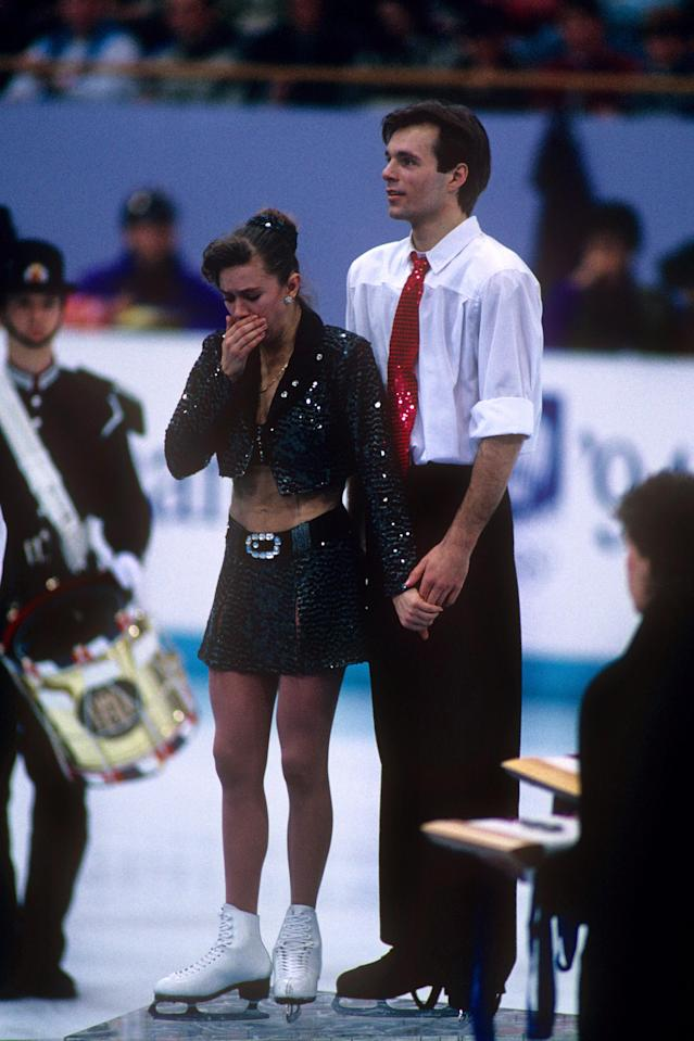 <p>Crop tops aren't allowed in figure skating competitions, but that didn't stop Russia's Oksana Grishuk at the Lillehammer Olympics. The gold medalist wore a faux-crop top and a sequined skirt and jacket combination. </p>