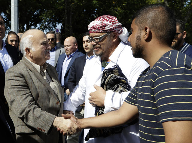 His Royal Highness Prince El Hassan bin Talal Hashemite, left, of the Kingdom of Jordan greets worshippers outside the Al Noor mosque in Christchurch, New Zealand, Saturday, March 23, 2019. The mosque reopened today following the March 15 mass shooting. (AP Photo/Mark Baker)