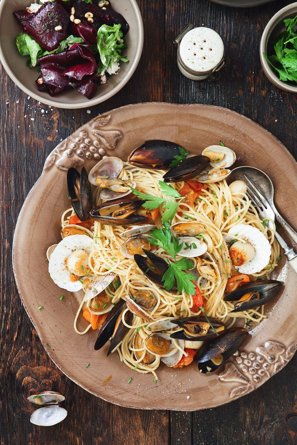 """<p>Celebrate like an Italian by indulging in their iconic seven-course seafood feast that dates back to the early 1900s. You can make an array of recipes at home, or avoid dirtying your dishes by finding a local Italian restaurant that offers a special Christmas Eve menu.</p><p><a class=""""link rapid-noclick-resp"""" href=""""https://www.amazon.com/s/ref=nb_sb_ss_i_3_7?url=search-alias%3Daps&field-keywords=seafood+tools&sprefix=seafood%2Caps%2C121&crid=27WI9QAA212DI&rh=i%3Aaps%2Ck%3Aseafood+tools&tag=syn-yahoo-20&ascsubtag=%5Bartid%7C10050.g.25411840%5Bsrc%7Cyahoo-us"""" rel=""""nofollow noopener"""" target=""""_blank"""" data-ylk=""""slk:SHOP SEAFOOD TOOLS"""">SHOP SEAFOOD TOOLS</a></p>"""