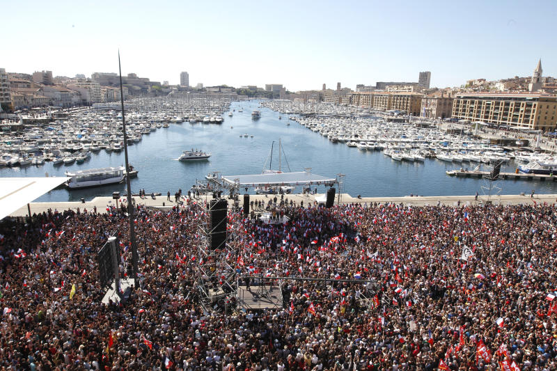 Supporters of French hard-left presidential candidate Jean-Luc Melenchon gather in Marseille's Old Port, southern France, to attend a campaign rally, Sunday, April 9, 2017. The two-round presidential election is set for April 23 and May 7. (AP Photo/Claude Paris)