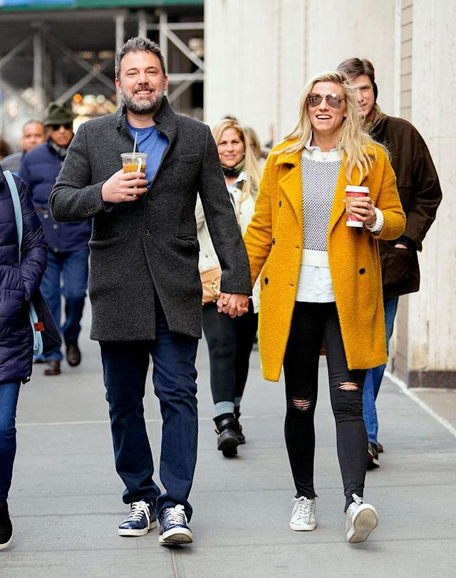 <p>Still together! The couple smiled big as they held hands and enjoyed a coffee date in New York City on Sunday. (Photo: Gotham/GC Images) </p>