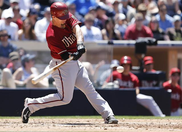 Arizona Diamondbacks' Tuffy Gosewisch drives a single up the middle to bring in two unearned runs against the San Diego Padres during the fourth inning of a baseball game on Sunday, May 4, 2014, in San Diego. (AP Photo/Lenny Ignelzi)