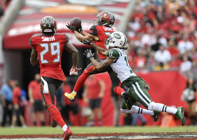 <p>Tampa Bay Buccaneers cornerback Brent Grimes (24) intercepts a pass during the first half of an NFL game between the New York Jets and the Tampa Bay Buccaneers on November 12, 2017, at Raymond James Stadium in Tampa, FL. (Photo by Roy K. Miller/Icon Sportswire) </p>