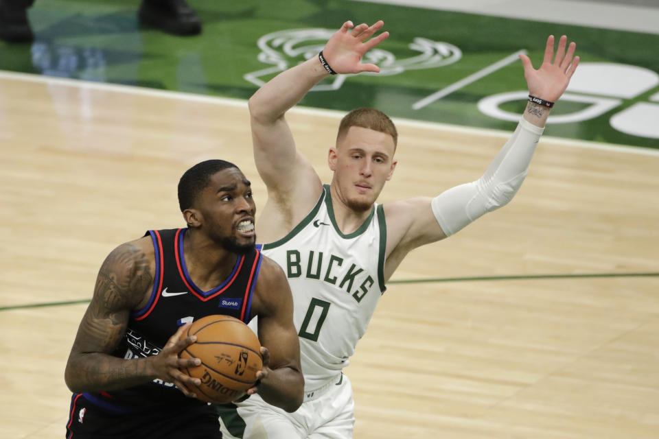 Philadelphia 76ers' Shake Milton drives to the basket against Milwaukee Bucks' Donte DiVincenzo (0) during the second half of an NBA basketball game Thursday, April 22, 2021, in Milwaukee. (AP Photo/Aaron Gash)