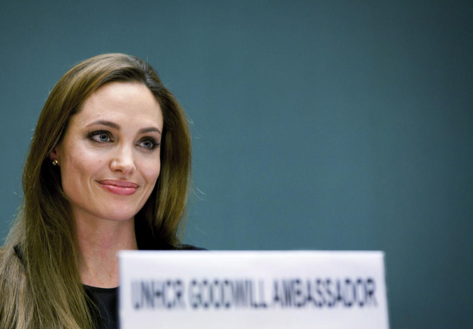 United Nations High Commissioner for Refugees (UNHCR) Goodwill Ambassador Angelina Jolie speaks during an annual meeting of UNHCR's governing executive committee in Geneva October 4, 2011. REUTERS/Jason Tanner/UNHCR/Handout (SWITZERLAND - Tags: ENTERTAINMENT SOCIETY) FOR EDITORIAL USE ONLY. NOT FOR SALE FOR MARKETING OR ADVERTISING CAMPAIGNS. MANDATORY CREDIT