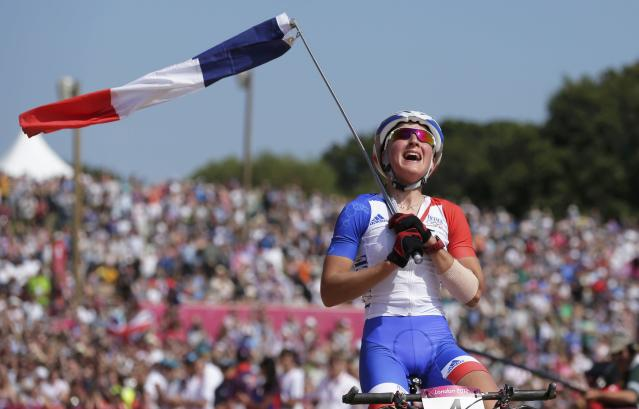 France's Julie Bresset celebrates after winning gold during the women's Cross-country mountain bike cycling event at Hadleigh Farm during the London 2012 Olympic Games, August 11, 2012. REUTERS/Cathal McNaughton (BRITAIN - Tags: SPORT CYCLING OLYMPICS TPX IMAGES OF THE DAY)