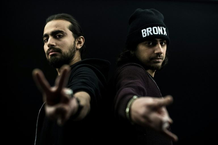 Brothers Yaser (L) and Mohamed Jamous, who set up Refugees of Rap in 2007, rap in Arabic about the war in Syria that they have fled and their new life in France