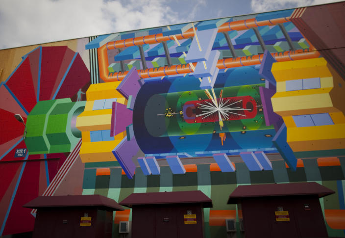 """FILE - In this May 20, 2011 file photo, a wall painting by artist Josef Kristofoletti is seen at the Atlas experiment site at the European Center for Nuclear Research, CERN, outside Geneva, Switzerland. The painting shows how a Higgs boson may look. Two scientific teams have for the first time precisely recorded an extremely rare event in physics that adds certainty to how we think the universe began, leaders at the world's top particle physics lab said Friday July 19, 2013. Two of the teams at the European Center for Nuclear Research, or CERN, say they measured a particle called """"Bs"""" decaying into a pair of muons, a fundamental particle. The results are being formally unveiled at a major physics conference in Stockholm later Friday. (AP Photo/Anja Niedringhaus,File)"""