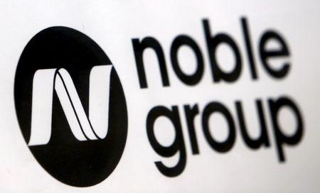 FILE PHOTO - A Noble Group sign is pictured at a meet-the-investors event in Singapore