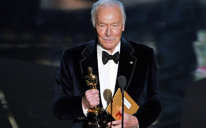 Picking up his Oscar for Beginners in 2012 - Kevin Winter/Getty Images