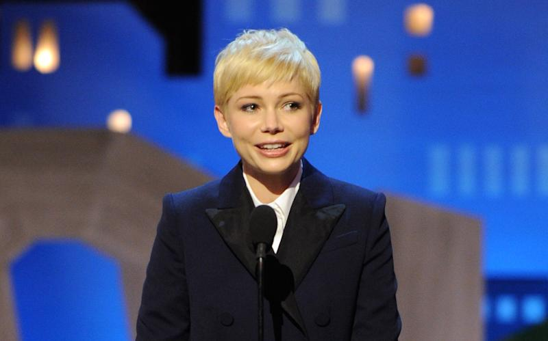 Michelle Williams accepts the best female lead award for My Week With Marilyn at the Independent Spirit Awards on Saturday, Feb. 25, 2012, in Santa Monica, Calif. (AP Photo/Vince Bucci)