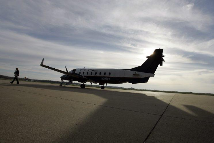 A pilot for Great Lakes Airlines walks away from her plane after landing at Cape Girardeau Regional Airport on March 25, 2009, in Cape Girardeau, Mo. (Photo: Jeff Roberson/AP)