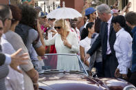 FILE - In this Tuesday, March 26, 2019 file photo, Camilla, Duchess of Cornwall, waves to onlookers during a cultural event in Havana, Cuba. Prince Charles and Camilla arrived in Cuba Sunday with an agenda including visits to historic sites, a solar park, organic farm, bio-medical research center, a meeting with entrepreneurs, a cultural gala and a dinner with Cuba's president. Prince Philip was the longest serving royal consort in British history. In Britain, the husband or wife of the monarch is known as consort, a position that carries immense prestige but has no constitutional role. The wife of King George VI, who outlived him by 50 years, was loved as the Queen Mother. Prince Charles' wife, Camilla, has worked to emerge from the shadow of his immensely popular first wife, Diana. (AP Photo/Ramon Espinosa, File)