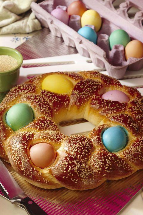 """<p>This Greek Easter bread features colorful eggs baked in the braided crown. </p><p><em><strong><a href=""""https://www.womansday.com/food-recipes/food-drinks/recipes/a13730/tsoureki-3195/"""" rel=""""nofollow noopener"""" target=""""_blank"""" data-ylk=""""slk:Get the Tsoureki recipe"""" class=""""link rapid-noclick-resp"""">Get the Tsoureki recipe</a>.</strong></em></p>"""