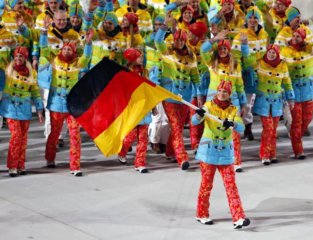 Maria Hoefl-Riesch of Germany carries her country flag as the team arrives during the opening ceremony of the 2014 Winter Olympics in Sochi, Russia, Friday, Feb. 7, 2014. (AP Photo/Petr David Josek)