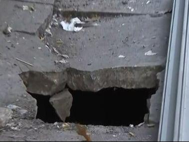 The hole in the Bronx pavement that Leonard Shoulders fell down on Saturday 24 October 2020 ((CBS New York))